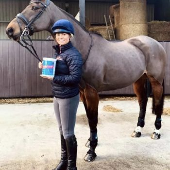 horse and rider with Equine Product OAP Supplement Tub